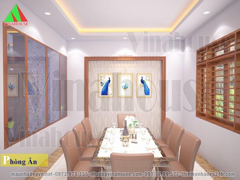 Phòng ăn thoáng ngăn cách phòng khách bằng vách trang trí